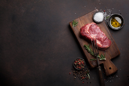 Raw ribeye beef steak cooking with ingredients. Top view with copy space Reklamní fotografie