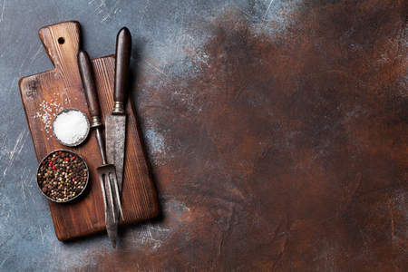 Vintage kitchen utensils and spices over cutting board. Cooking concept. Top view with space for your text Stockfoto