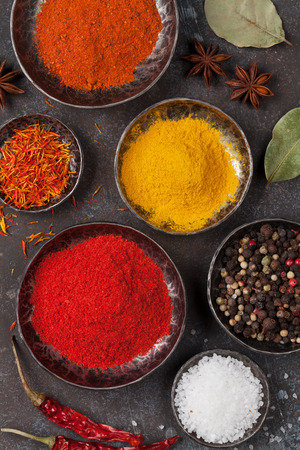 Colorful spices on stone table. Top view Banco de Imagens