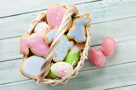 Easter gingerbread cookies on a wooden table. Eggs and rabbits. Top view