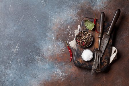 Vintage kitchen utensils and spices over cutting board. Cooking concept. Top view with space for your text Standard-Bild