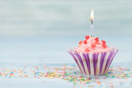 Sweet cupcake with candle. With space for your greetings