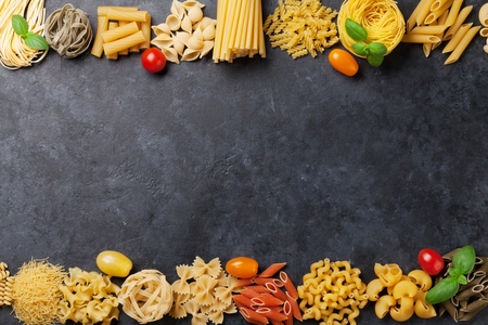 Various pasta. Cooking concept. Top view with space for your text Фото со стока