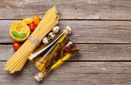 Various pasta and condiments. Cooking concept. Top view with space for your recipe