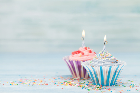 Sweet cupcakes with candles. With space for your greetings Standard-Bild