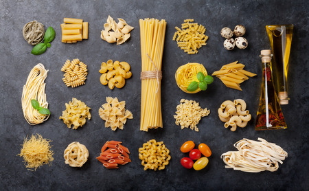 Various pasta and condiments. Cooking concept. Top view