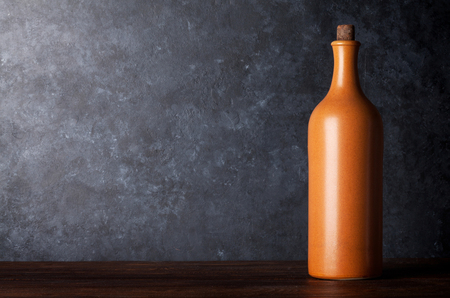 Red wine bottle in front of blackboard wall. With copy space for your text