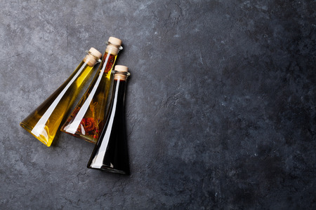 Olive oil and vinegar bottles. Top view with space for your recipe. Cooking concept Archivio Fotografico - 98005250