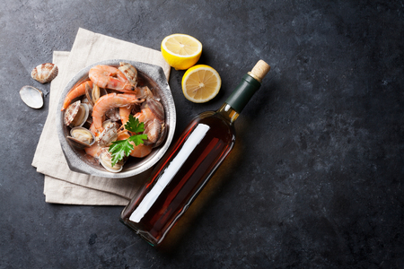 Fresh seafood and white wine on stone table. Top view with copy space Stockfoto