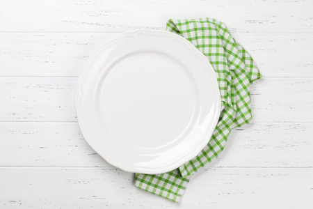 Empty plate on wooden table. Top view with space for your meal