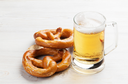 Lager beer and pretzel on wooden table