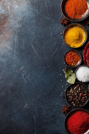 Colorful spices on stone table. Top view with space for your recipe Archivio Fotografico - 99421134