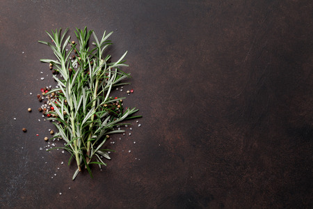 Rosemary herbs on dark stone table. Top view with space for your recipe Stock fotó - 99421158