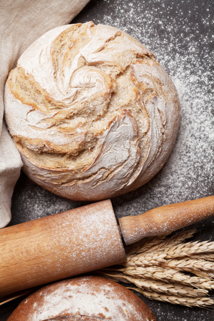 Homemade crusty bread on blackboard background. Top view Stock Photo