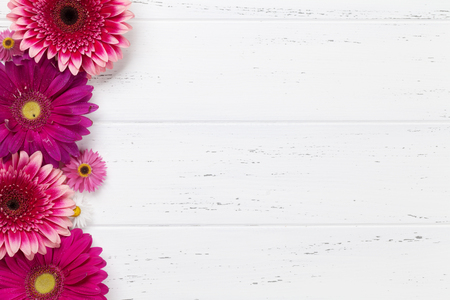 Gerbera flowers bouquet on wooden table. Top view with space for your text
