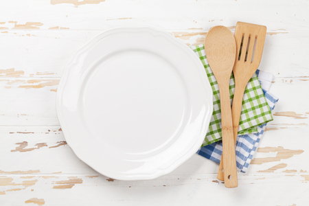 Empty plate with utensils on wooden table. Top view with space for your meal Stock Photo - 100020012