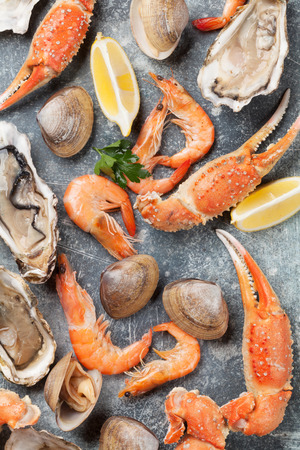 Seafood. Oysters, lobster, clams and shrimps. Top view on stone table Archivio Fotografico - 100669457
