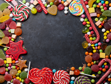 Colorful sweets. Lollipop and candies. Top view with space for your text