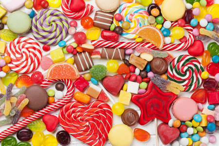 Colorful sweets. Lollipops and candies. Top view closeup