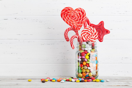 Colorful sweets. Lollipops and candies. With space for your greetings