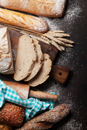 Various crusty bread and buns cooking. Top view Banque d'images