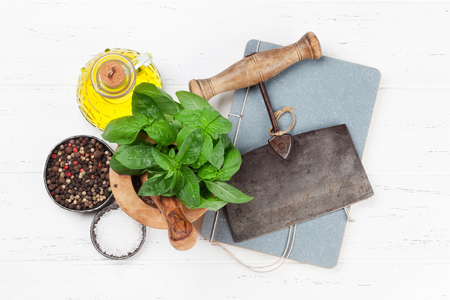 Italian cuisine. Basil, olive oil and spices cooking. Top view with space for your recipe Stock Photo
