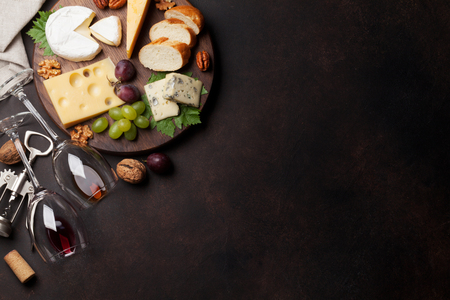 Wine, grape, bread, nuts and cheese. Top view with space for your text Reklamní fotografie