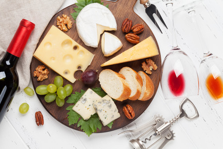 Wine, cheese, grape, bread and nuts. Top view
