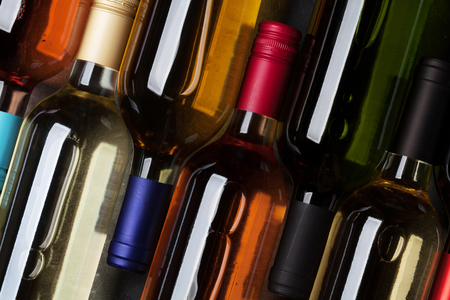 Red, rose and white wine bottles. Top view Stock Photo