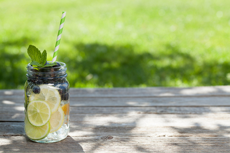 Fresh lemonade jar with summer fruits and berries. With space for your text