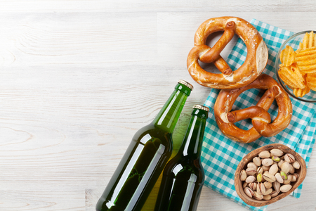 Lager beer and snacks on wooden table. Nuts, chips, pretzel. Top view with copy space Stock Photo