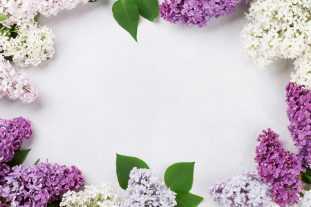Colorful lilac flowers over stone background. Top view with space for your text