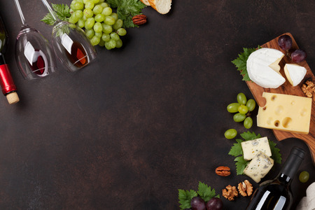 Wine, grape, nuts and cheese. Top view with space for your text Archivio Fotografico