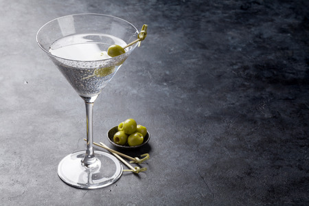 Martini cocktail on dark stone table. With space for your text