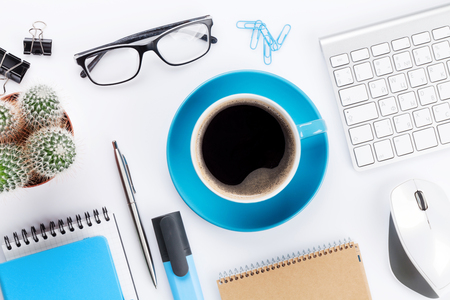 White office desk with coffee, computer and supplies. Tabletop. Top view Stock Photo