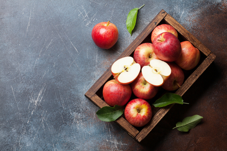 Ripe red apples in wooden box. Top view with space for your text