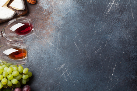 Wine, grape, nuts and cheese. Top view with space for your text Stock Photo