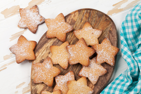 Star shaped cookies on wooden table. Top view Stock Photo