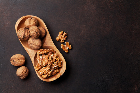 Walnut nuts in bowl. Top view with space for your text Zdjęcie Seryjne