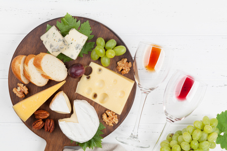 Wine, cheese, grape, bread and nuts. Top view with space for your text Archivio Fotografico