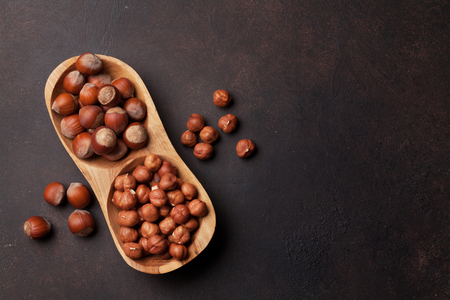 Hazelnut nuts in bowl. Top view with space for your text