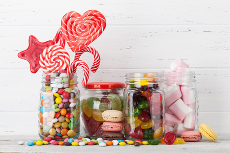 Colorful sweets. Lollipops, macaroons, marshmallow, marmalade and candies