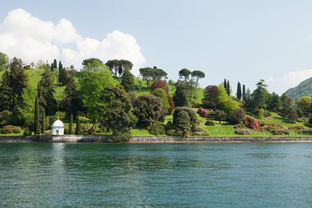 Lake Como garden landscape, Lombardy region, Italy, Europe. View from water Standard-Bild - 105577013