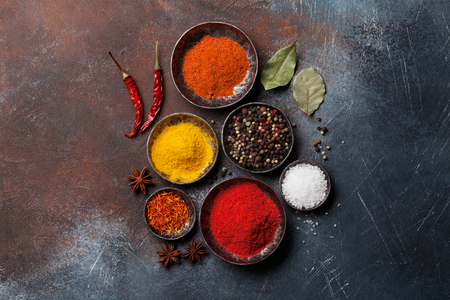 Colorful spices on stone table. Top view Stock Photo
