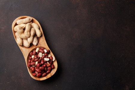 Peanut nuts in bowl. Top view with space for your text
