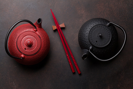 Red and black teapots and sushi chopsticks. Top view Stok Fotoğraf