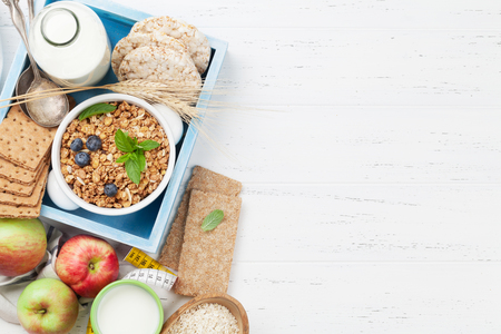 Healthy breakfast set with muesli, berries and milk. Top view with space for your text