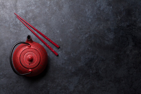 Red tea pot and sushi chopsticks. Top view with space for your text Stok Fotoğraf