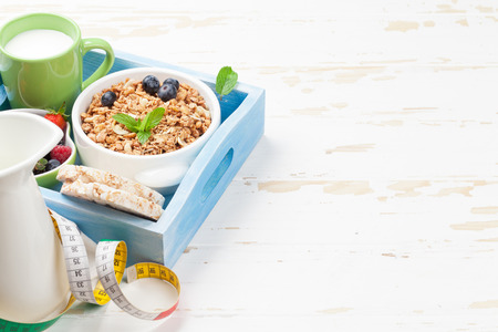 Healthy breakfast set with muesli, berries and milk. With space for your text