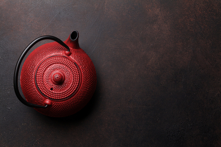 Red tea pot. Top view with space for your text